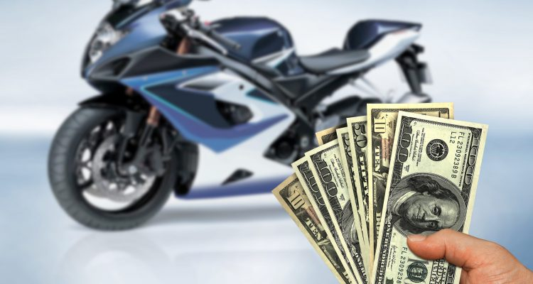 Motorcycle and person holding money