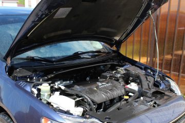 scrap car with hood up