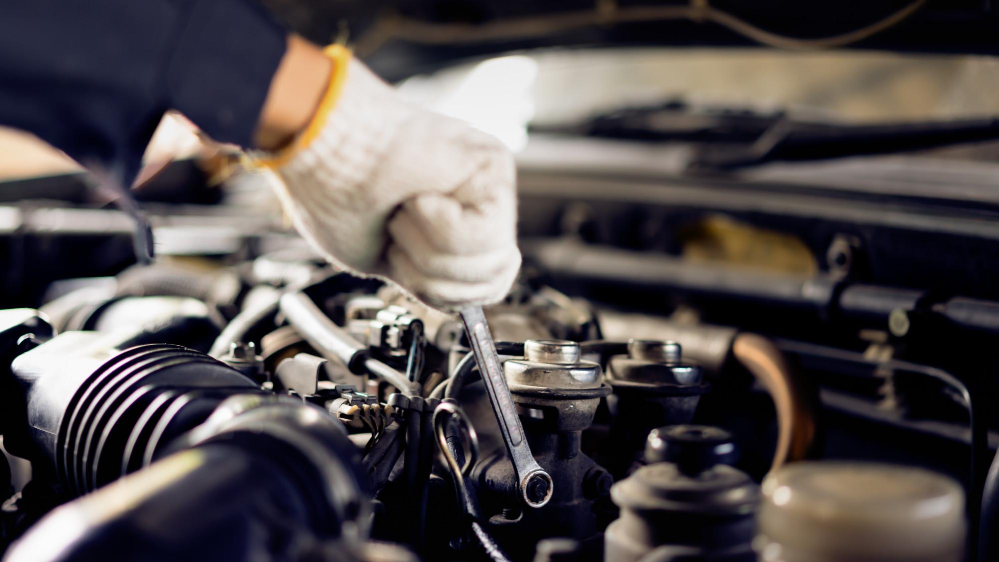 person performing DIY car maintenance