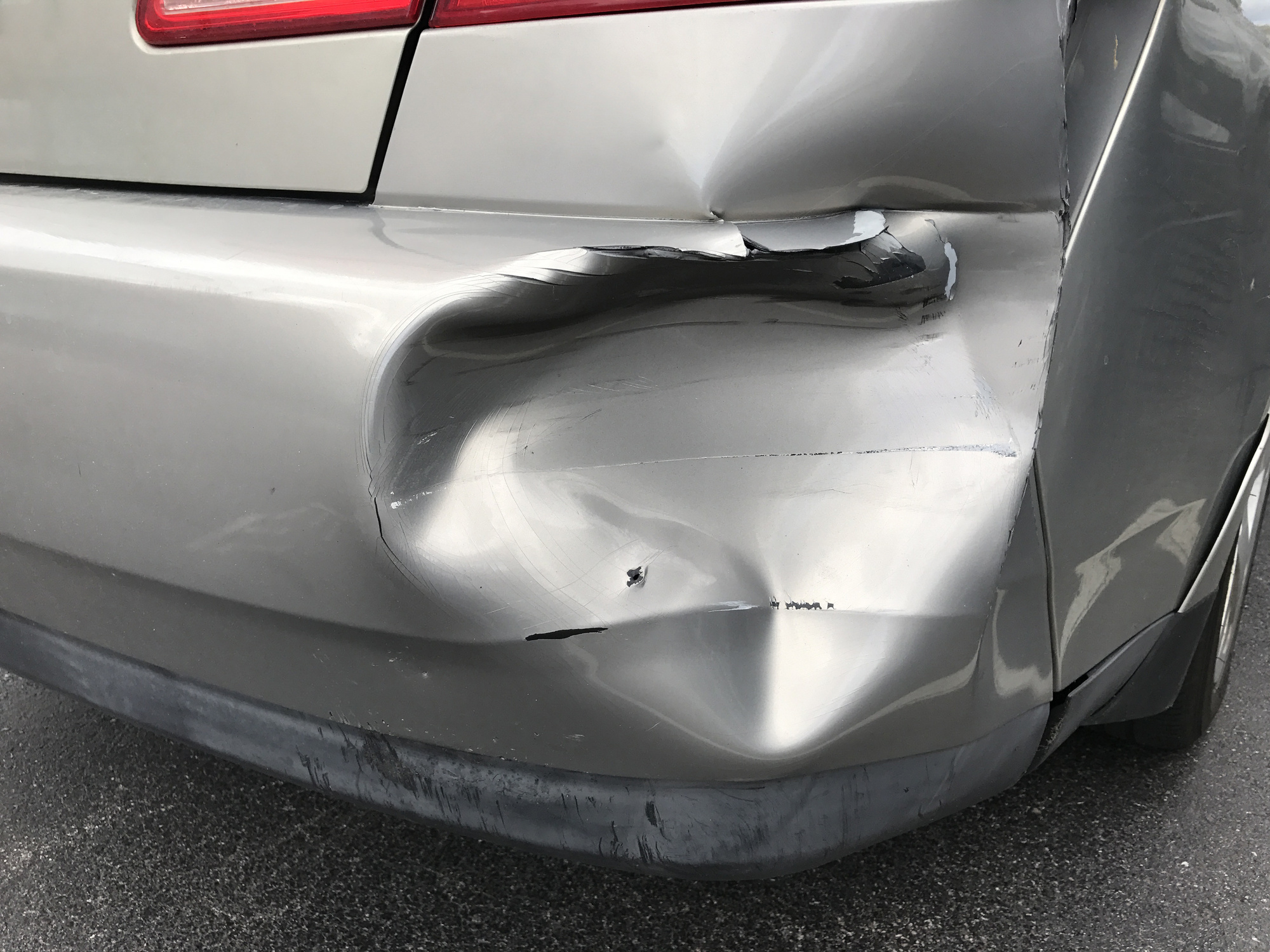 dent in car bumper