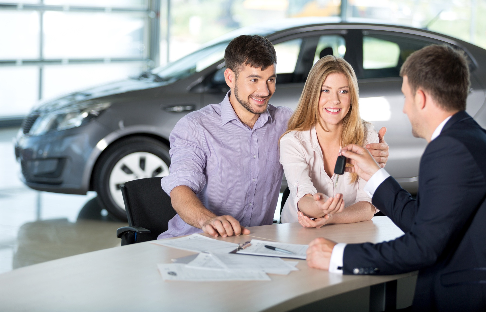 couple buying car from dealership