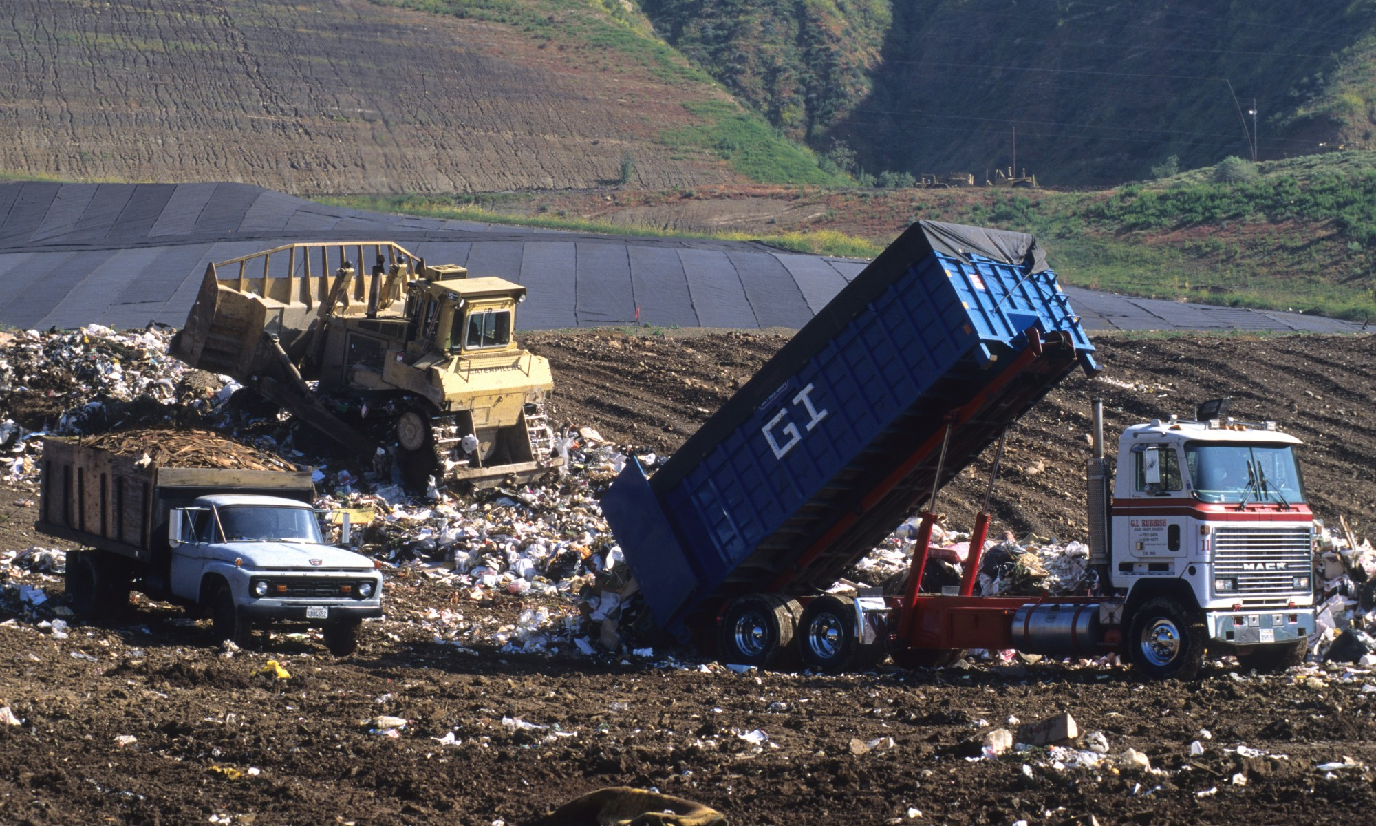garbage trucks at dump
