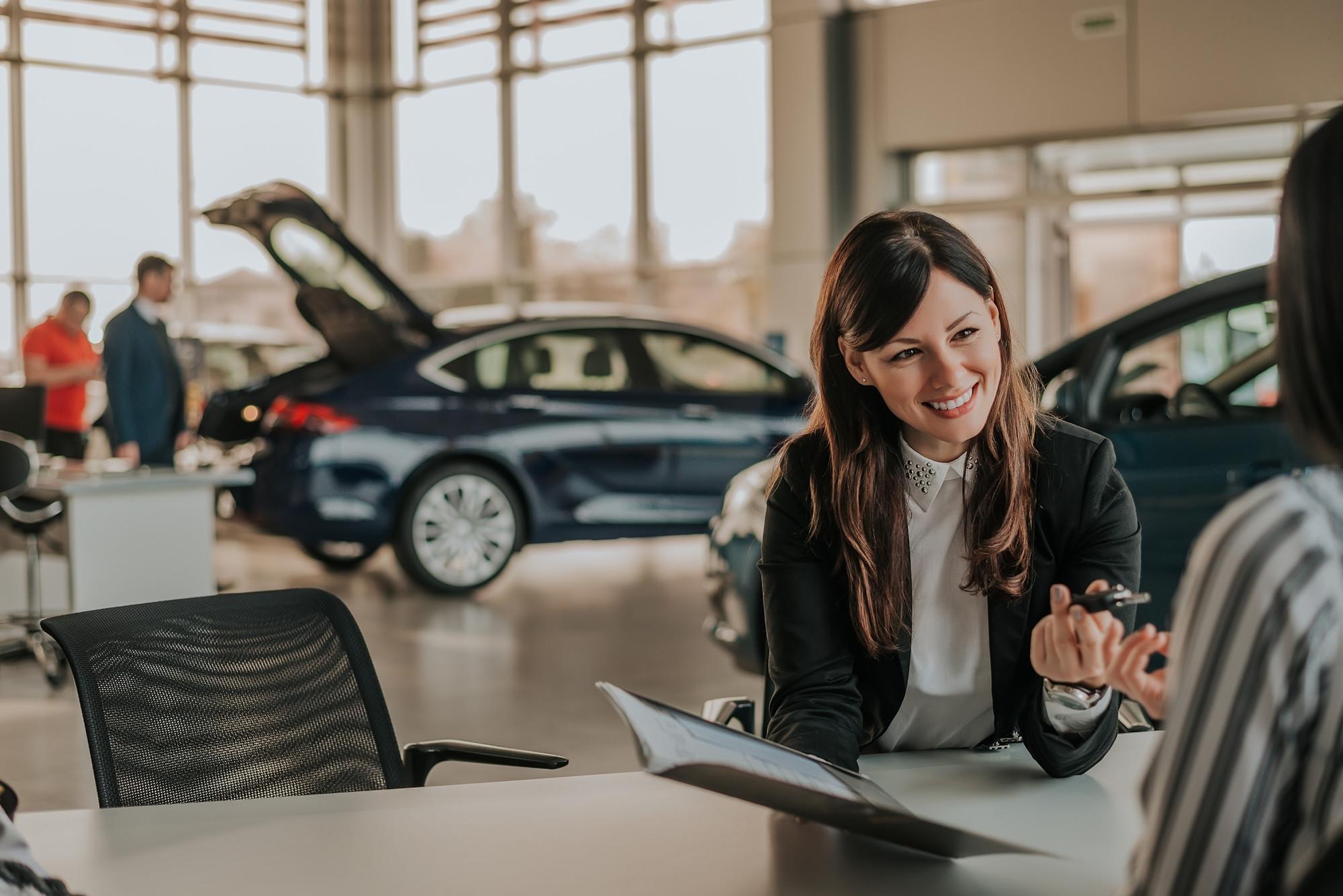 woman buying car at dealership