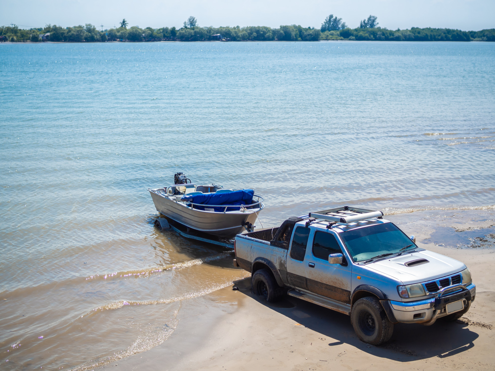 Car Towing a Boat on a Trailer