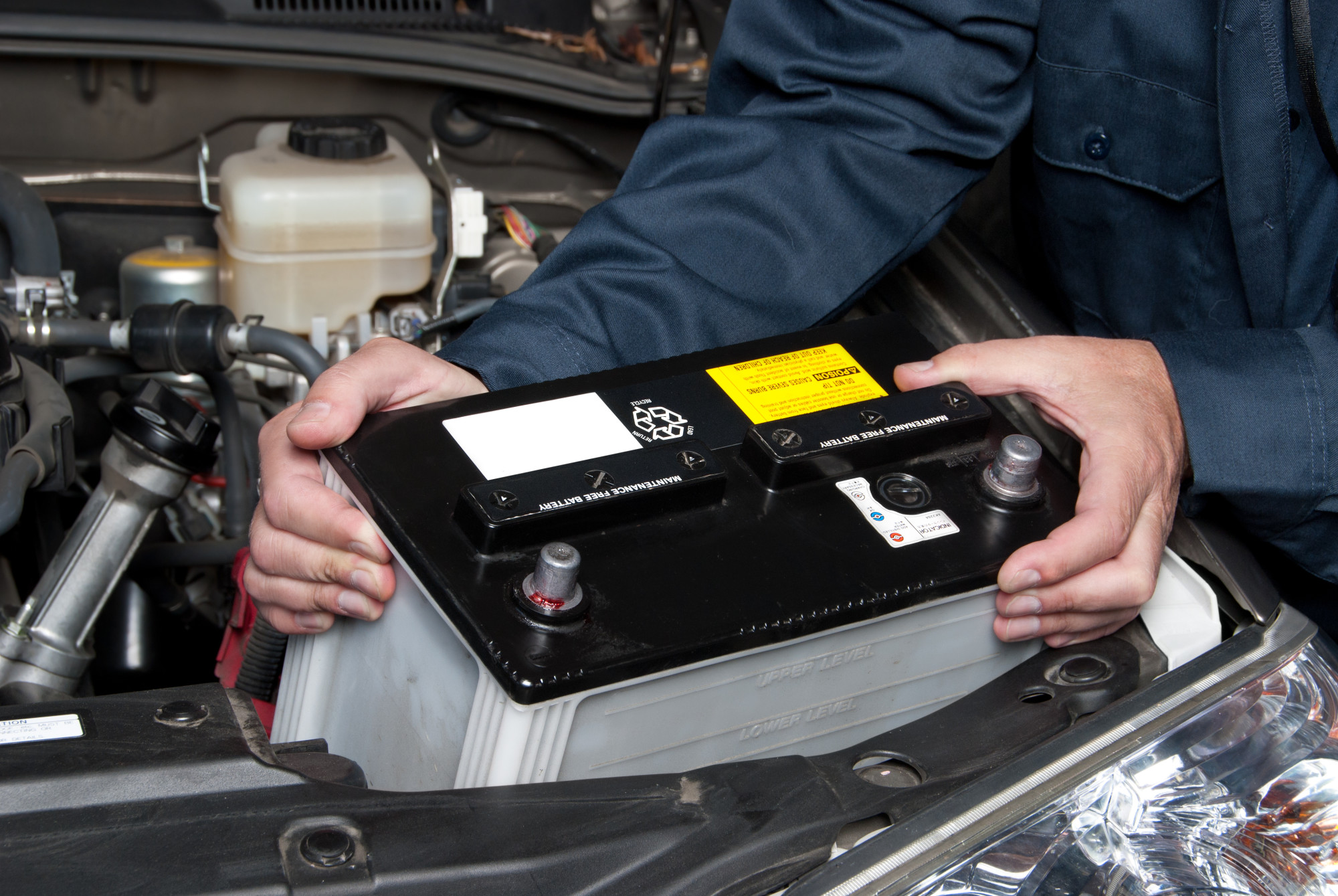 Man Replacing Car Battery