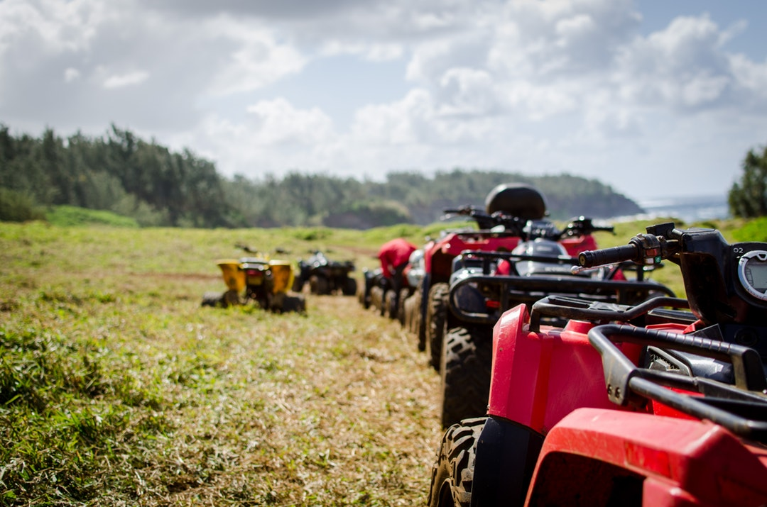 Line of Four Wheel All Terrain Vehicles