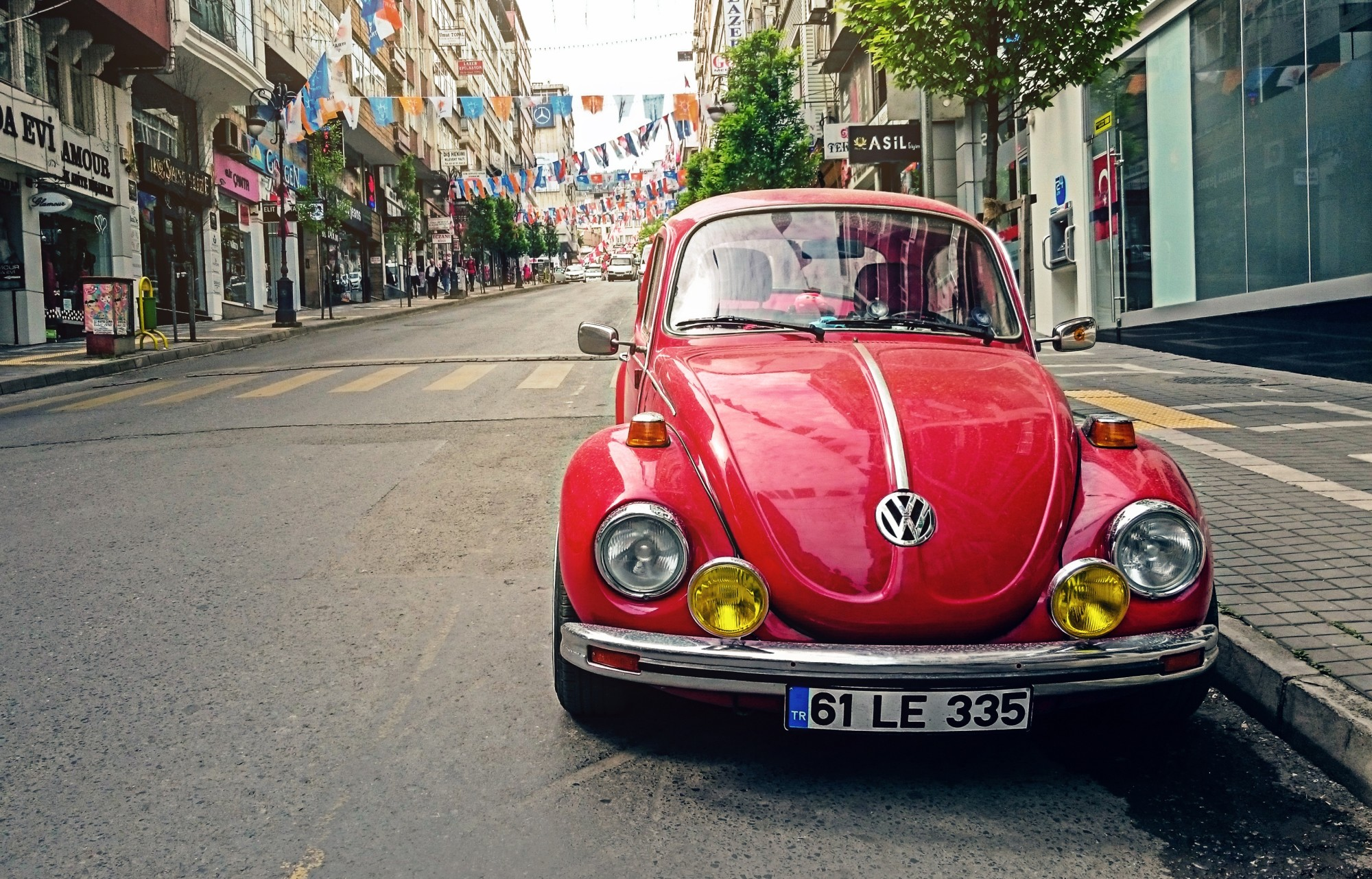 Red Volkswagen Parked on Roadside