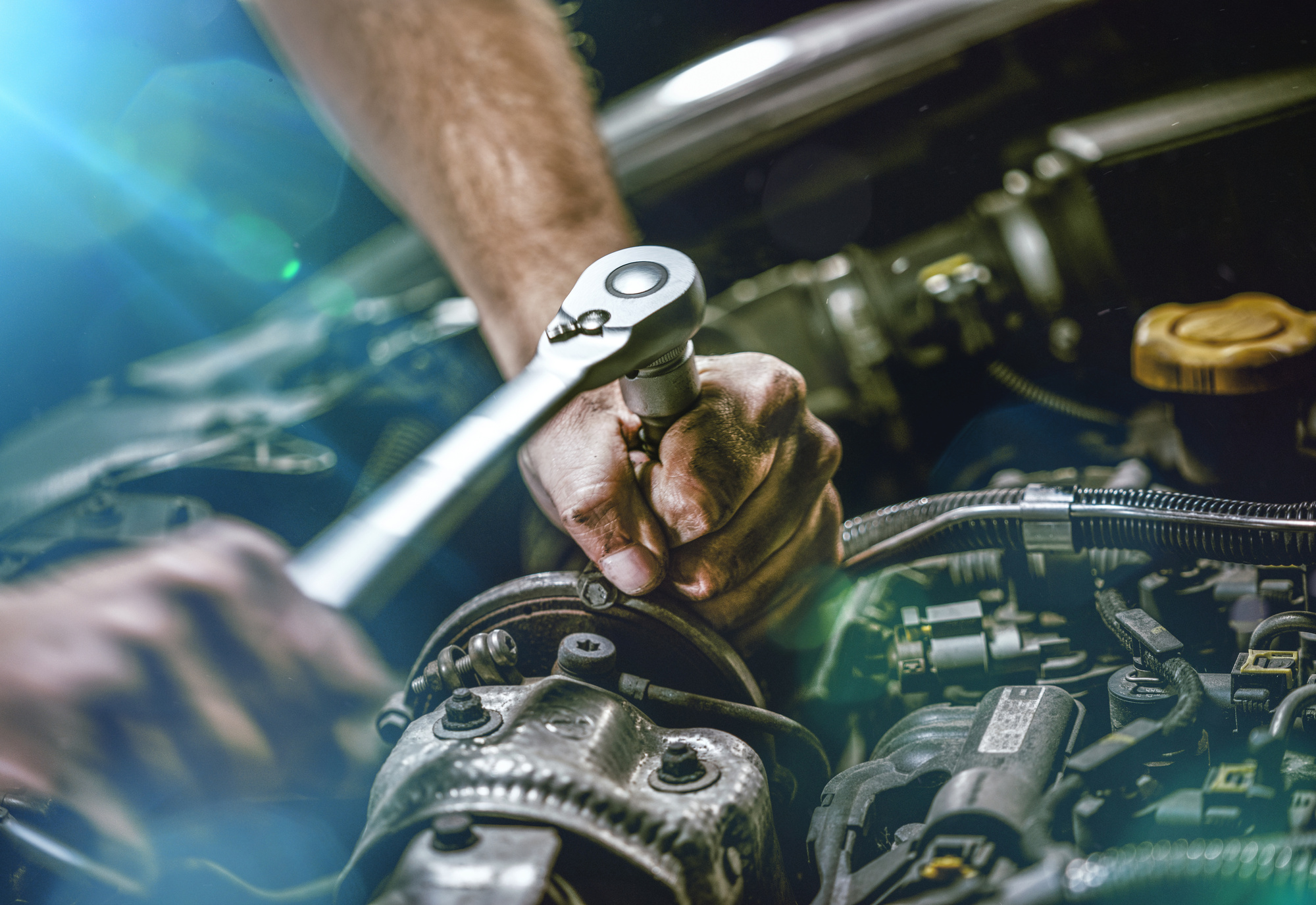 Mechanic Doing Engine Works on a Car