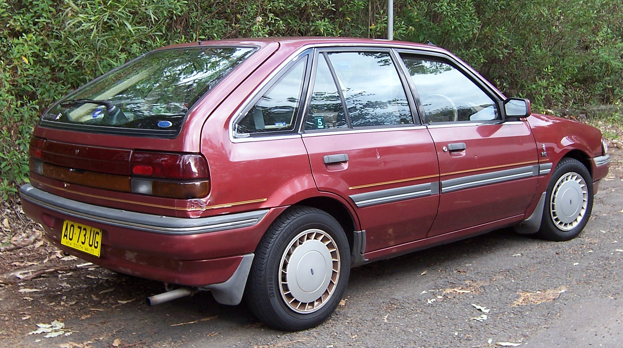 Ford Laser Ghia: Photos, Reviews, News, Specs, Buy car