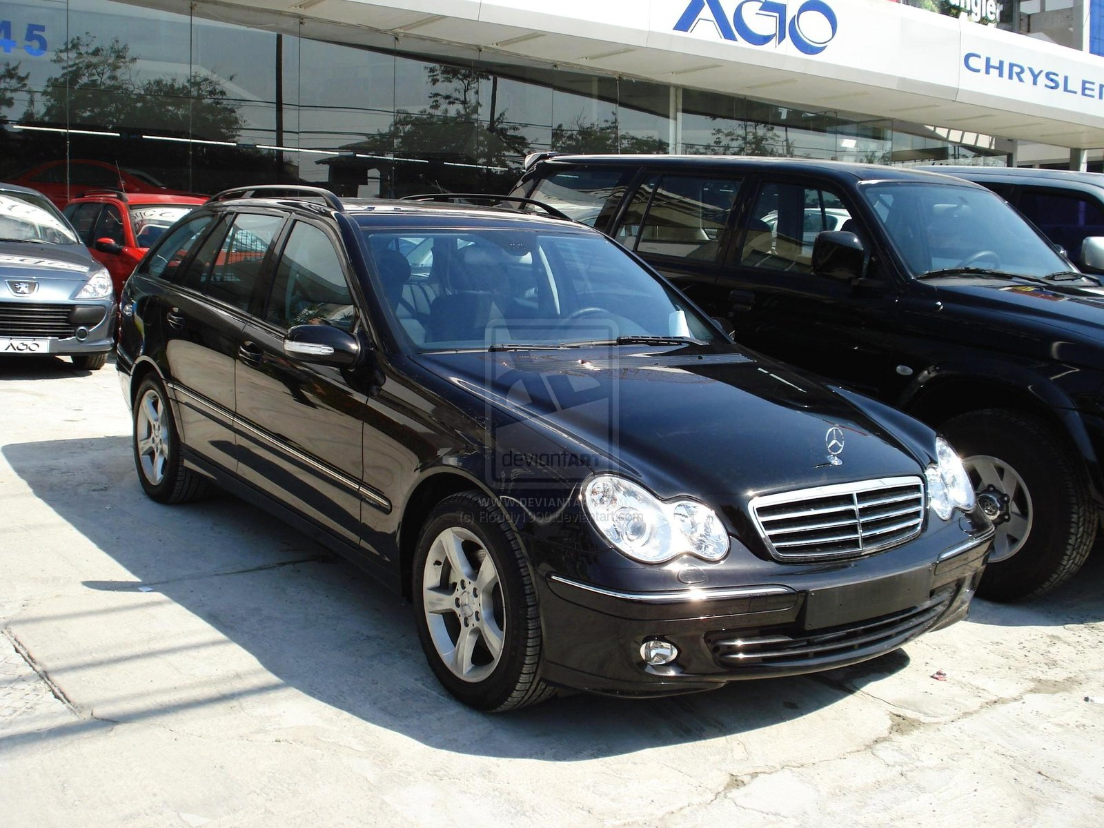 Mercedes benz c 230 touring photos reviews news specs for Mercedes benz touring car