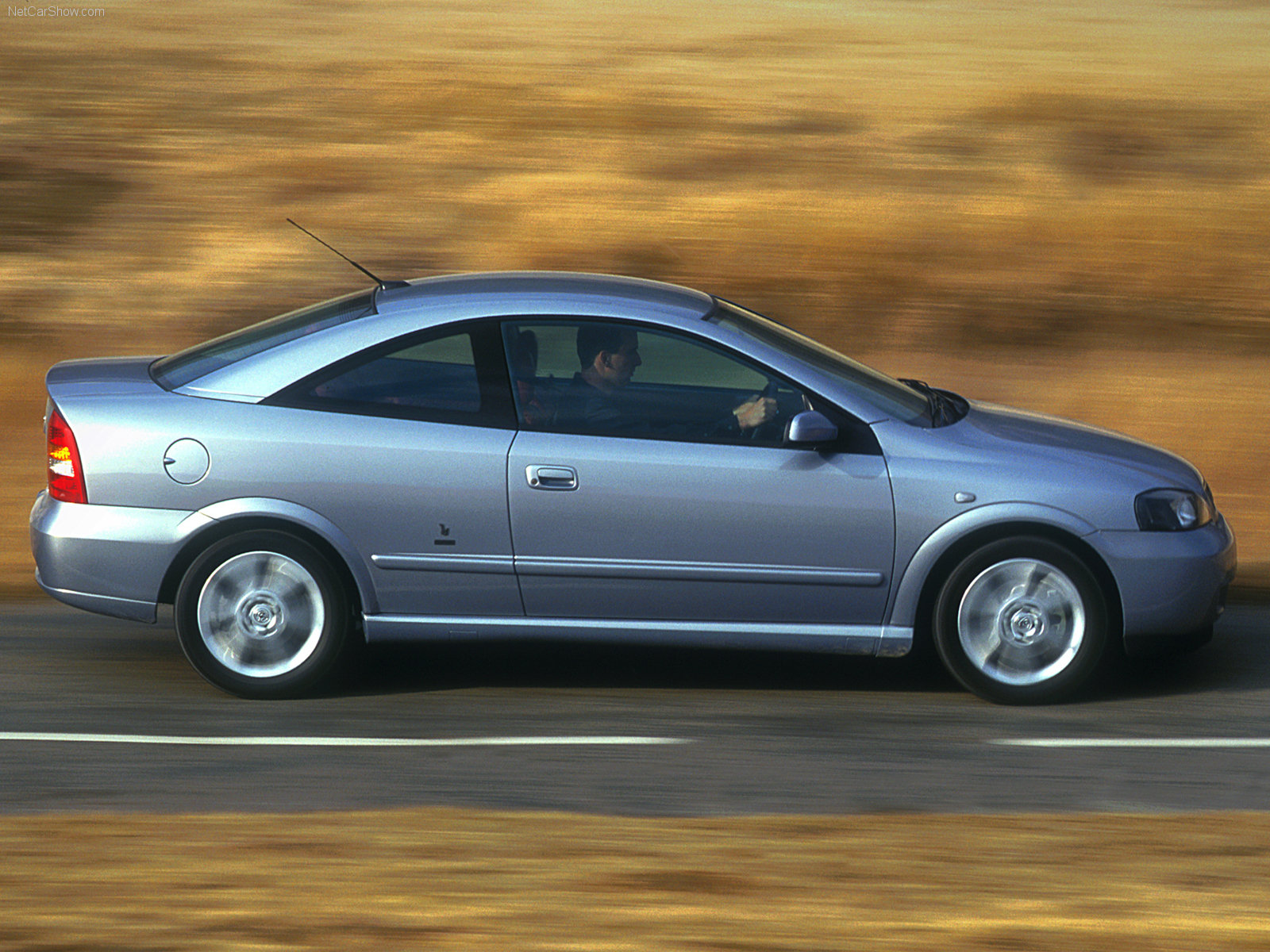 vauxhall astra coupe photos news reviews specs car listings. Black Bedroom Furniture Sets. Home Design Ideas